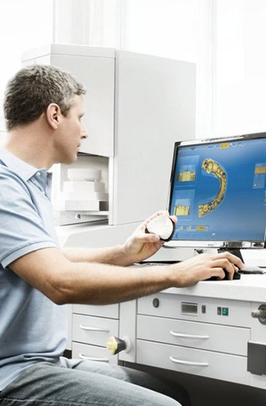 Dentist using CEREC system