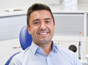 Smiling man in dental chair